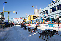 Peter Kaiser and team leave the ceremonial start line with an Iditarider and handler at 4th Avenue and D street in downtown Anchorage, Alaska on Saturday March 4th during the 2017 Iditarod race. Photo © 2017 by Brendan Smith/SchultzPhoto.com.