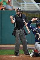 Umpire John Bacon makes a call during a game between the New Hampshire Fisher Cats and Harrisburg Senators on July 21, 2015 at Metro Bank Park in Harrisburg, Pennsylvania.  New Hampshire defeated Harrisburg 7-1.  (Mike Janes/Four Seam Images)