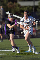Boston College midfielder Sam Taylor (14) on the attack as University at Albany defender Stephanie Kempf (21) defends. University at Albany defeated Boston College, 11-10, at Newton Campus Field, on March 30, 2011.