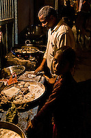 A chef hard at work in the backstreets of Varanasi.<br /> (Photo by Matt Considine - Images of Asia Collection)