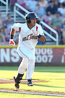 Fernando Pujadas #17 of the Salem-Keizer Volcanoes runs to first base during a game against the Spokane Indians at Volcanoes Stadium on July 26, 2014 in Keizer, Oregon. Spokane defeated Salem Keizer, 4-1. (Larry Goren/Four Seam Images)