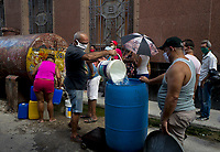 HAVANA, CUBA - April 24: People wearing face masks to prevent Coronavirus contagious wait to collect water during the spread of the (COVID-19) desease on April 24, 2020. in Havana, Cuba. The Caribbean country has experienced relatively mild Covid-19 diseases. where roughly 11.5 million people living in the island, has so far registered 40 cases with a single death, according to the Cuban Ministry of Public Health.  (Photo by Eliana Aponte/VIEWpress)