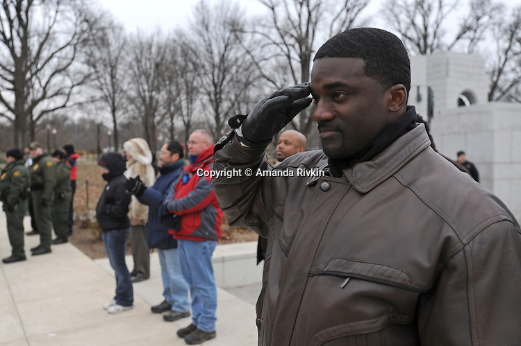"A man salutes during ""The Star Spangled Banner"" at the ""We Are One"" concert in celebration of Barack Obama's inauguration as president of the United States at the Lincoln Memorial in Washington DC on January 18, 2009."