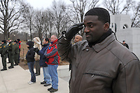 """A man salutes during """"The Star Spangled Banner"""" at the """"We Are One"""" concert in celebration of Barack Obama's inauguration as president of the United States at the Lincoln Memorial in Washington DC on January 18, 2009."""