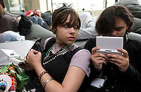Photo by Stephen Brashear.Meadow Lindsey of Seattle, left, and cousin Betsey Lindsey of Bellevu play Animal Cross Wild World on their Nintendo DSs in the DS Lounge on the first day Penny Arcade Exposition at the Washington State Visitor and Convention Center in Seattle, Wash., Friday Aug. 29, 2008.