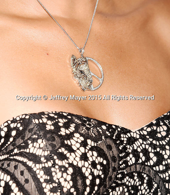 BEVERLY HILLS, CA - OCTOBER 24: Actress Katie Cleary, jewelry detail, at the Last Chance for Animals Benefit Gala at The Beverly Hilton Hotel on October 24, 2015 in Beverly Hills, California.