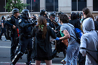 Protestors clash with police officers in Washington, D.C., U.S., on Sunday, May 31, 2020, following the death of an unarmed black man at the hands of Minnesota police on May 25, 2020.  Credit: Stefani Reynolds / CNP/AdMedia