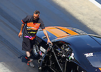 Jun 18, 2016; Bristol, TN, USA; Crew member for NHRA pro mod driver Dan Stevenson during qualifying for the Thunder Valley Nationals at Bristol Dragway. Mandatory Credit: Mark J. Rebilas-USA TODAY Sports