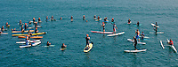 Tom Jones is surrounded by local surfers who paddled out to greet him upon his arrival at Ocean Beach, Saturday, November 3 2007.  Tom began paddling his 14ft paddle board along the length of the California coastline on August 4th in Crescent City California.  He plans to be the first person to paddle the entire coast and hopes to bring awareness  to the problem of plastic pollution in our oceans along the way.  Ocean Beach was the second to last leg of the trip which was due to finish near the Mexican border in Imperial Beach on Sunday, November 4 2007.