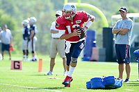 August 1, 2017: New England Patriots quarterback Tom Brady (12) works to avoid training aids being thrown at him during the New England Patriots training camp held at Gillette Stadium, in Foxborough, Massachusetts. Eric Canha/CSM
