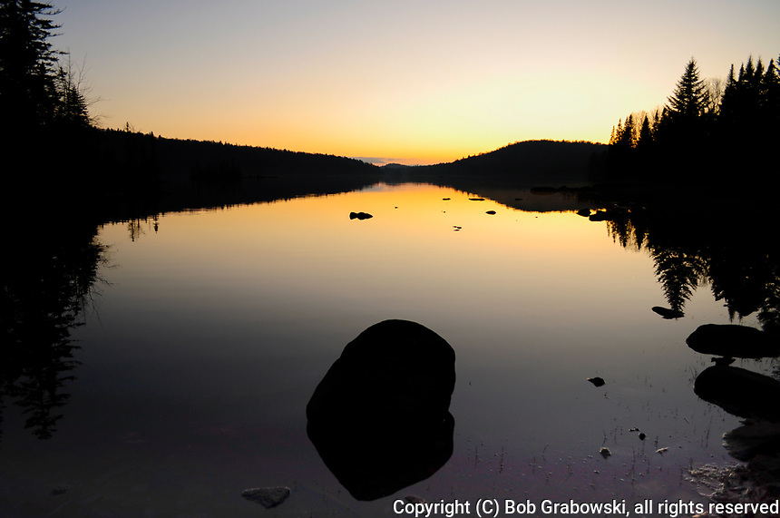 Sunset on a calm Cedar Lake in the Adirondack Mountains in New York State