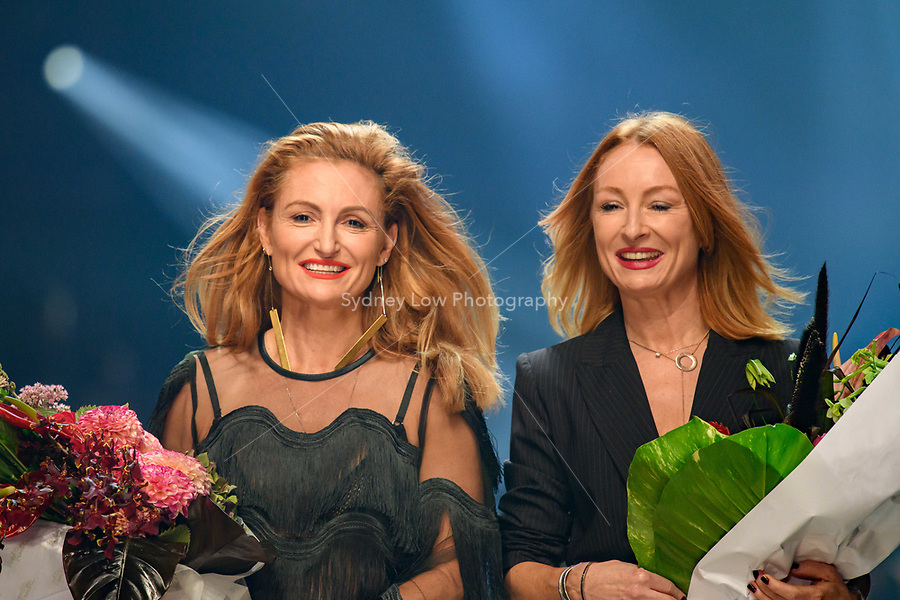 8 March 2018, Melbourne - Alexandra and Genevieve Smart accept flowers after a parade showcasing their designs at the Virgin Australia Grand Showcase show at the 2018 Virgin Australia Melbourne Fashion Festival in Melbourne, Australia. (Photo Sydney Low / asteriskimages.com)