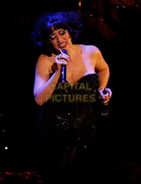 Meow Meow.Inside at the Opening night of 'Meow Meow In Concert' at the Apollo Theatre, Shaftesbury Avenue, London, England, UK, June 23rd 2011..half length strapless black corset bustier music on stage live gig concert singing cabaret microphone .CAP/COA/CC.©CC/COA/Capital .
