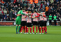 Pictured: Southampton players huddle before kick off Sunday 01 February 2015<br /> Re: Premier League Southampton v Swansea City FC at ST Mary's Ground, Southampton, UK.