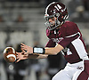 Colin Hart #14 of Garden City takes a snap during the Nassau County Conference II varsity football final against Mepham at Hofstra University on Friday, Nov. 17, 2017. Garden City won by a score of 33-0.