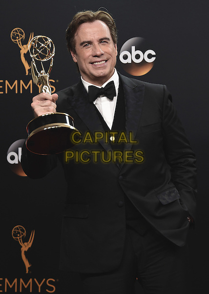 LOS ANGELES, CA - SEPTEMBER 18:  John Travolta in the press room at the 68th Emmy Awards at the Microsoft Theater on Sunday, September 18, 2016, in Los Angeles, California. <br /> CAP/MPI99<br /> &copy;MPI99/Capital Pictures
