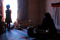 A Saharawi family are seeninto his house on December 14, 2003, in the Saharawi refugee camps. Saharawi people have been living at the refugee camps of the Algerian desert named Hamada, or desert of the deserts, for more than 30 years now. Saharawi people have suffered the consecuences of European colonialism and the war against occupation by Moroccan forces. Polisario and Moroccan Army are in conflict since 1975 when Hassan II, Moroccan King in 1975, sent more than 250.000 civilians and soldiers to colonize the Western Sahara when Spain left the country. Since 1991 they are in a peace process without any outcome so far. (Ander Gillenea / Bostok Photo)