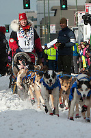 Aliy Zirkle and team leave the ceremonial start line with an Iditarider at 4th Avenue and D Street in downtown Anchorage, Alaska on Saturday, March 5th during the 2016 Iditarod race. Photo by Joshua Borough/SchultzPhoto.com