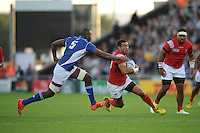 Siale Piutau of Tonga is tackled by Tjiuee Uanivi of Namibia during Match 20 of the Rugby World Cup 2015 between Tonga and Namibia - 29/09/2015 - Sandy Park, Exeter<br /> Mandatory Credit: Rob Munro/Stewart Communications