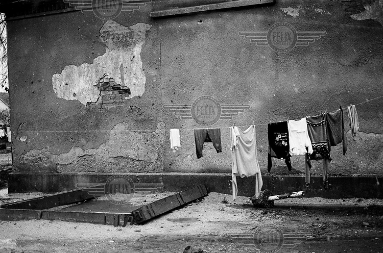 Clothes drying on a line at the Varazdin refugee camp in the winter of 1992. <br /> <br /> In 1992 while volunteering at the Varazdin refugee camp Panos photographer Bjoern Steinz met and became close to Elvis, a Bosnian Muslim refugee, and his family. They shared the hardships of camp life together which Steinz documented. While the prints were archived for many years two of the images always returned to Bjoern's thoughts. 25 years later he set out to try and find out what had happened to Elvis and his family in the intervening years. Modern social media made the task surprisingly easy and they were reunited in Hadzici where Elvis now lives with his family.