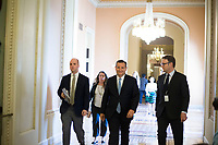 United States Senator Ted Cruz (Republican of Texas), accompanied by staff, walks from the US Senate Chamber in the US capital in Washington, DC on Friday, December 1, 2017.  <br /> Credit: Alex Edelman / CNP /MediaPunch