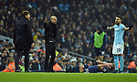 Nicolas Otamendi of Manchester City waves at Tottenham Hotspur Manager Mauricio Pochettino after the challenge on Harry Kane of Tottenham Hotspur during the premier league match at the Etihad Stadium, Manchester. Picture date 16th December 2017. Picture credit should read: Robin ParkerSportimage