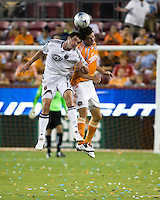 D.C. United forward Chris Pontius (13) and Houston Dynamo defender Bobby Boswell (32) go up for the header.  Houston Dynamo defeated D.C. United 4-3 at Robertson Stadium in Houston, TX on August 1, 2009.