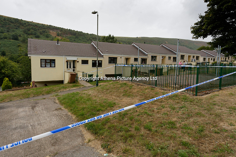 Pictured: The house (L) where the body of David Gaut was discovered in New Tredegar, Wales, UK. Wednesday 08 August 2018<br /> Re: Three men have been arrested after a man was found dead at a house in New Tredegar, Wales, UK.<br /> David Gaut, 54, was found in Long Row, in the Elliots Town area of New Tredegar, on Saturday, August 4.<br /> Two two-storey terraced homes, owned by Caerphilly council, have been cordoned off and police officers are patrolling the area. <br /> David Gaut was jailed for life in July 1985 when he was 21 years old, for the murder and torture of17-month old Chi Ming Shek