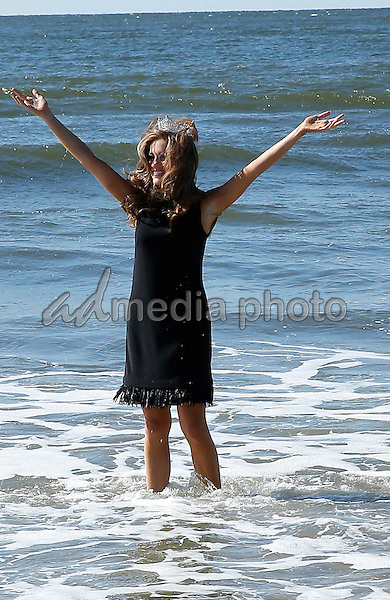 14 September 2015 - Atlantic City, NJ- 2016 Miss America, Betty Cantrell.  Newly Crowned Miss America Betty Cantrell dips her toes in the surf at the Atlantic City beach.  Photo Credit: MJT/AdMedia