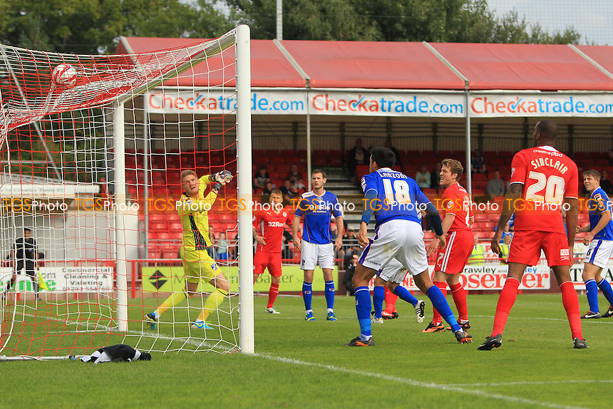 Josh Simpson of Crawley Town scores the opener - Crawley Town vs Oldham Athletic - Sky Bet League One Football at the Broadfield Stadium Crawley, West Sussex - 28/09/13 - MANDATORY CREDIT: Simon Roe/TGSPHOTO - Self billing applies where appropriate - 0845 094 6026 - contact@tgsphoto.co.uk - NO UNPAID USE