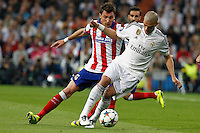 Real Madrid's Portuguese defense Pepe and Atletico Madrid´s Croatian forward Mario Mandzukic