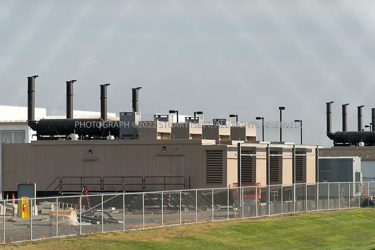 8/20/2012--Quincy, WA..Microsoft's massive server farm in Quincy, WASH. The data center has dozens of diesel generators (seen here) that nearby residents complain fill the air with exhaust when used...Quincy has seen rapid growth of data centers, or server farms, spurred on by tax breaks and low cost electricity produced by the Grant Count PUD's nearby hydroelectric dams. Microsoft and five other companies, including Yahoo and Dell, have brought big, energy-hungry data centers to Quincy in recent years, converting former bean fields into vital hubs on the internet...©2012 Stuart Isett. All rights reserved.