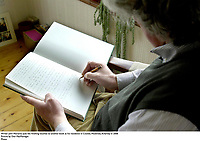 Writer John Moriarty puts the finishing touches to another book at his residence in Coolies, Muckross, Killarney in 2006<br /> Picture by Don MacMonagle