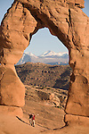 Utah, Arches National Park, Delicate Arch, La Sal Mountains in the distance, American Southwest, USA,.