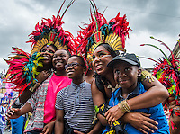Carnival Dancers taking time out from the procession to pose for pictures with the crowd at Huddersfileds Caribean Carnival, Huddersfield Town Centre, Britain. 11/07/2015