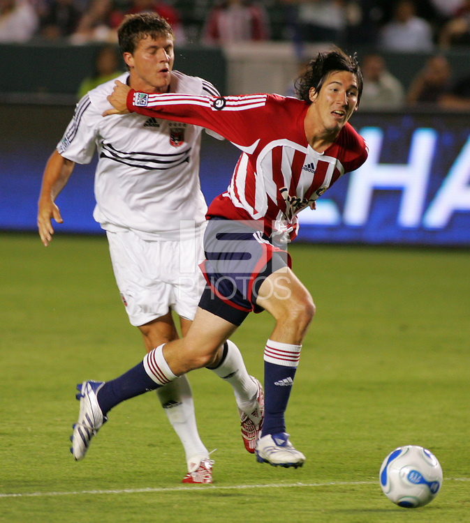 CD Chivas USA midfielder Sacha Kljestan (16) battles DC United defender Marc Burch (4) for the ball. CD Chivas USA tied D. C. United 2-2 during an MLS regular season match at the Home Depot Center, Carson, CA, on September 6, 2007.