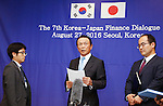 Taro Aso, Aug 27, 2016 : Japanese Finance Minister Taro Aso (C) speaks during a press conference after a talks with his South Korean counterpart Yoo Il-ho (not seen in photo) at an office of the South Korean Government Complex Seoul in Seoul, South Korea. The bilateral meeting was the seventh talks between Japan and South Korea since 2006. The finance ministers from Japan and South Korea agreed on Saturday to resume a currency swap deal to strengthen bilateral economic cooperation, local media reported. (Photo by Lee Jae-Won/AFLO) (SOUTH KOREA)