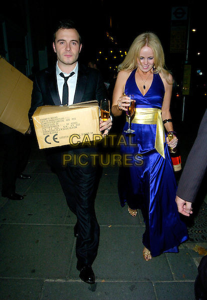 SHANE FILAN & GILLIAN FILAN (WESTLIFE).Leaving The Pink Ice Ball, The Waldorf Hilton Hotel..London, England, October 5th 2007..full length married couple wife box blue dress gold sash belt.CAP/CAN.©Can Nguyen/Capital Pictures