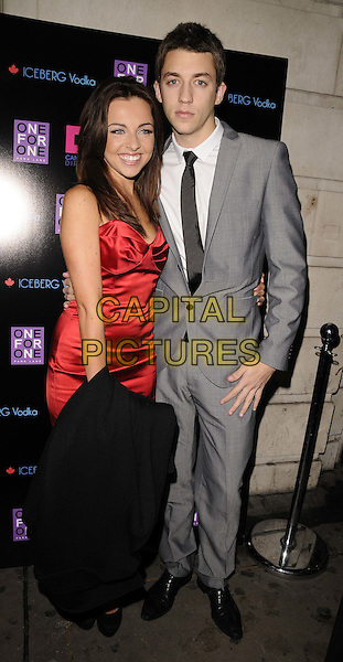 Louisa Lytton & guest.The Vincent & Flavia's post - Strictly / pre - Midnight Tango party, One For One Park Lane nightclub, Park Lane, London, England..December 19th, 2011.full length red silk satin dress grey gray suit strapless .CAP/CAN.©Can Nguyen/Capital Pictures.