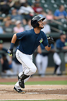 Third baseman Rigoberto Terrazas (9) of the Columbia Fireflies runs out a batted ball in a game against the Greenville Drive on Saturday, May 26, 2018, at Spirit Communications Park in Columbia, South Carolina. Columbia won, 9-2. (Tom Priddy/Four Seam Images)