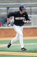 Evan Stephens (5) of the Wake Forest Demon Deacons hustles down the first base line against the Florida State Seminoles at Wake Forest Baseball Park on April 19, 2014 in Winston-Salem, North Carolina.  The Seminoles defeated the Demon Deacons 4-3 in 13 innings.  (Brian Westerholt/Four Seam Images)