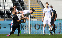 SWANSEA, WALES - MARCH 25: Daniel James of Swansea City is tackled by Rui Moreira of Porto during the Premier League International Cup Semi Final match between Swansea City and Porto at The Liberty Stadium on March 25, 2017 in Swansea, Wales. (Photo by Athena Pictures)