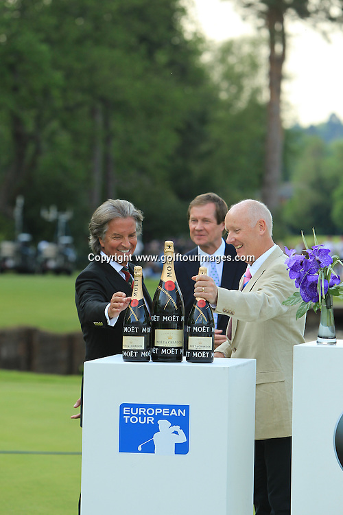 Richard Caring owner of Wentworth (left) and Tim Abbot, MD of BMW UK ( right) present Justin Rose and Paul Lawrie with champagne fortheir result in finishing joint second on 11 under par. The 2012 BMW PGA Championships played over the West Course, Wentworth, Surrey, England from 24th to 27th May 2012: Picture Stuart Adams www.golftourimages.com:  27th May 2012