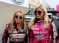 Oct 6, 2013; Mohnton, PA, USA; NHRA funny car driver Courtney Force (right) with her sister top fuel dragster driver Brittany Force during the Auto Plus Nationals at Maple Grove Raceway. Mandatory Credit: Mark J. Rebilas-