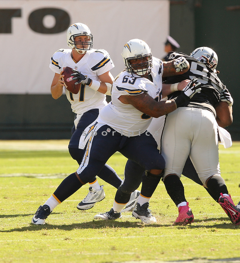 San Diego Chargers Johnnie Troutman (63) during a game against the Oakland Raiders on October 12, 2014 at O.co Coliseum in Oakland, CA. The Chargers beat the Raiders 31-28.
