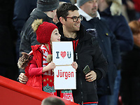 30th October 2019; Anfield, Liverpool, Merseyside, England; English Football League Cup, Carabao Cup, Liverpool versus Arsenal; a young Liverpool fan next to the players tunnel holds up a sign with a message for Liverpool manager Jurgen Klopp as the teams take to the field  - Strictly Editorial Use Only. No use with unauthorized audio, video, data, fixture lists, club/league logos or 'live' services. Online in-match use limited to 120 images, no video emulation. No use in betting, games or single club/league/player publications