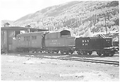 RGS rotary #2 sits by engine house at Rico with water car #W12, a C-16 tender behind.<br /> RGS  Rico, CO  8/1947