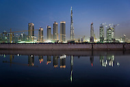 The Burj Dubai and buildings under construction reflected in Business Bay, Dubai