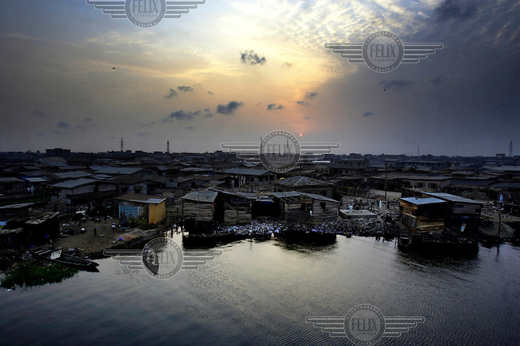 The sun sets over a slum in Lagos.