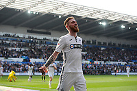 SWANSEA, WALES - APRIL 19: Oli McBurnie of Swansea City celebrates scoring his side's fourth goal during the Sky Bet Championship match between Swansea City and Rotherham United at the Liberty Stadium on April 19, 2019 in Swansea, Wales. (Photo by Athena Pictures/Getty Images)